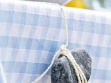 a large pebble on yarn is a cool idea to hold the tablecloth in place outdoors
