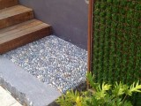 pebbles may be incorporated into garden paths to add a natural feel and make them more durable