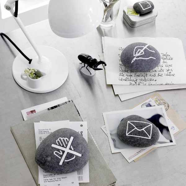 stylish paperweights of pebbles with modern images are a fun idea for your work desk