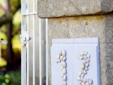 a house number done with pebbles is a cute DIY for a coastal home