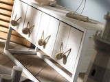 spruce up a usual sideboard adding rope and pebbles to the drawers as handles, it's a great idea for coastal houses