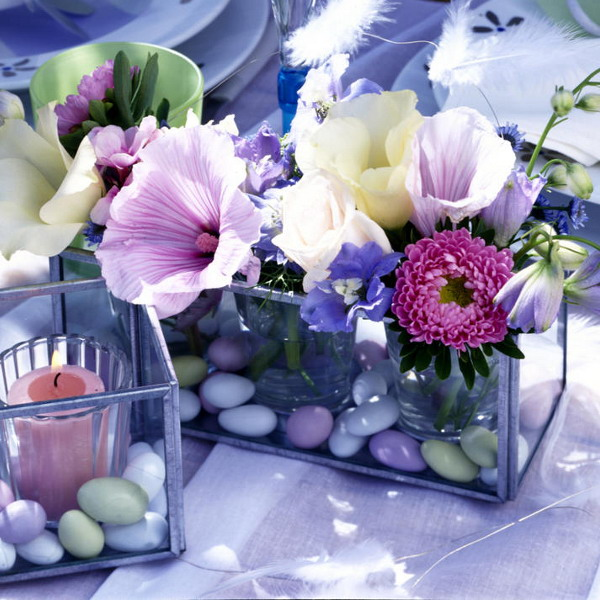 a glass box with pebbles and water plus bright blooms is a cool and bold centerpiece for any party