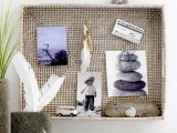 a holiday shadow box with pics, driftwood and toys plus pebble photos
