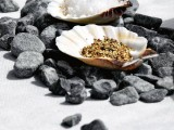 pebbles placed on the table, with shells filled with condiments is a creative idea of a sea tablescape