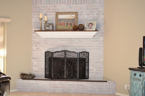 big whitewashed brick fireplace (via homesteadlove)