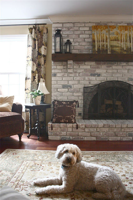 traditional whitewashed brick fireplace (via theyellowcapecod)