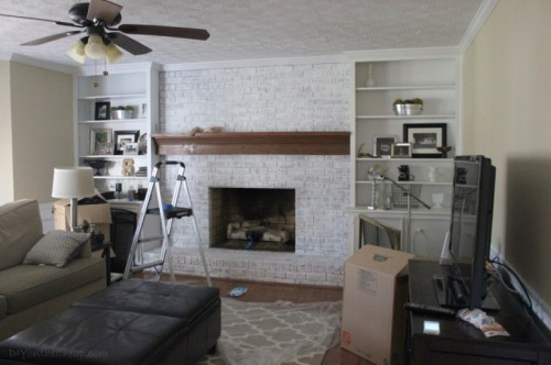whitewash a brick fireplace and its wall (via diyonthecheap)