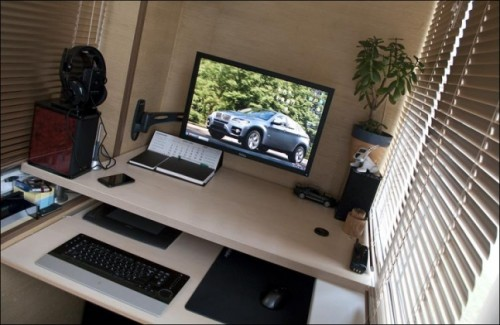 In small apartments it's a pretty common idea to use a balcony not only for storage but also as a home office.