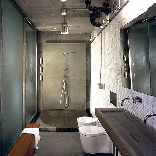 Bare concrete works extremely well for a bathroom design