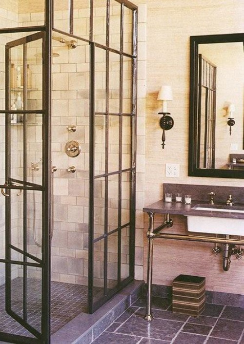Metal sink vanity and unusual shower doors add a touch of industrial style to this bathroom.