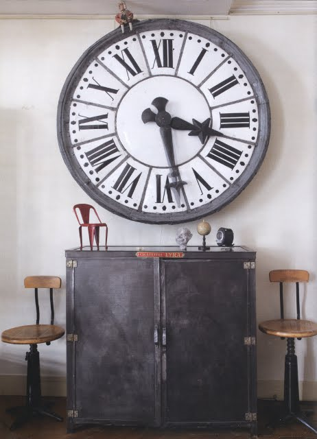 Oversized clock and an antique dresser works well for a hallway in industrial style