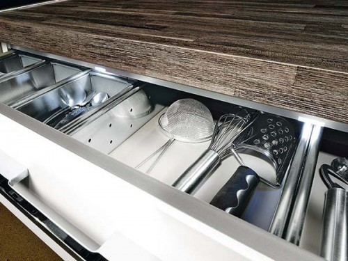 Slim kitchen utensils organizer should be somewhere by the cooktop.