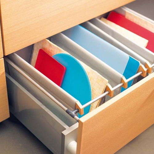 You can store your cooking boards and trays in a drawer using simple dividers.