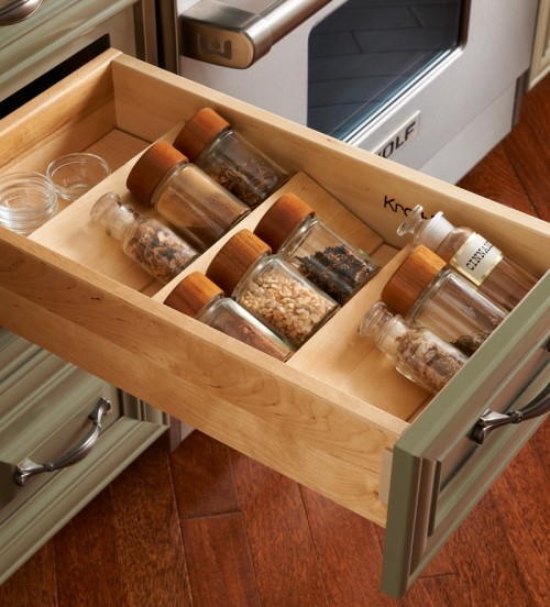 Top drawer is perfect for storing spice jars.