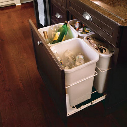 Several recycling trash  cans could fit one large pull out drawer.