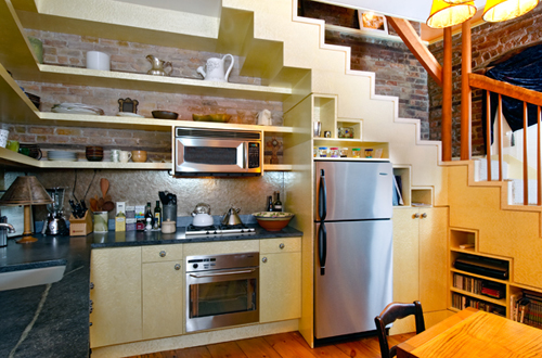 Elegant Kitchen With Open Shelves Under The Staircase (via Blog)