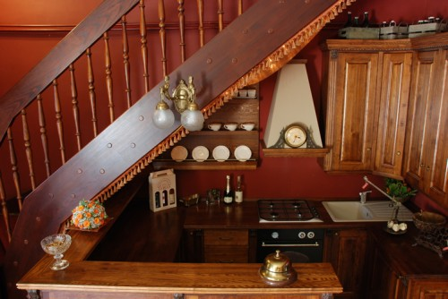 Traditional Solid Wood Kitchen Under The Stairs (via 1900)