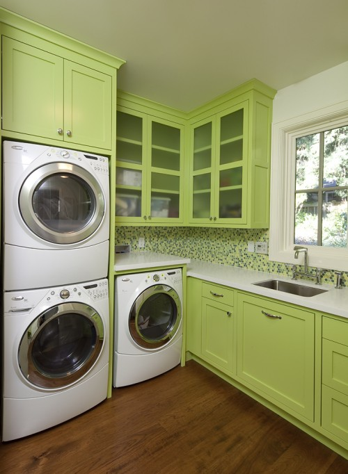 Cute light green laundry room design is anything but boring.