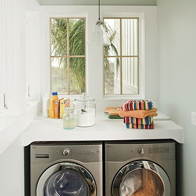 Lovely Little Laundry Room Design With A Window Above Washing Liances