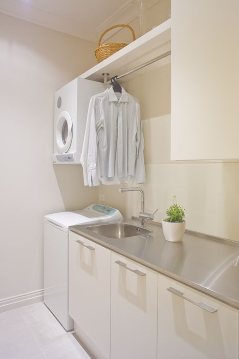 if you have a compact dryer you can hang it right on a wall - Laundry Design Ideas