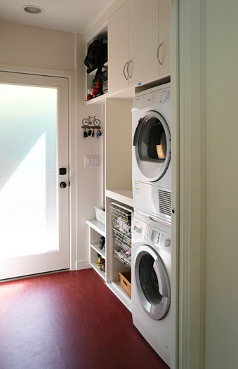 Placing a drying and a washer on top of each other is a smart space saving solution for small utility rooms.