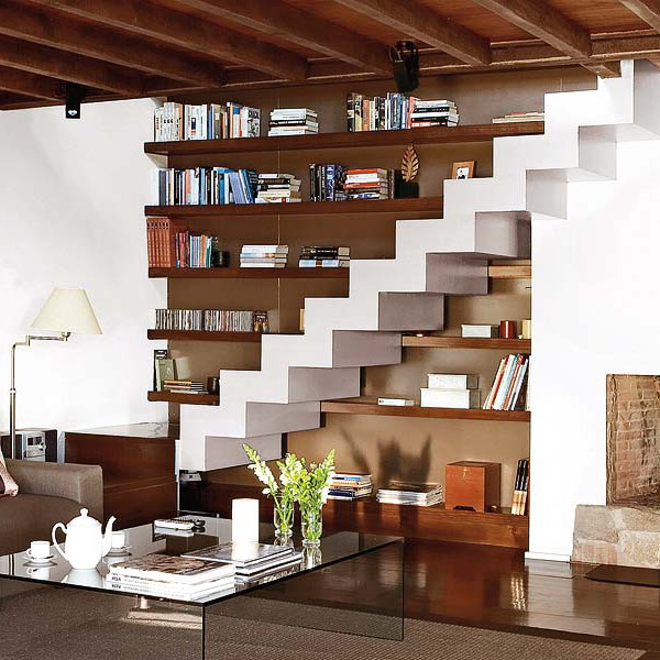 chic and simple open shelves under the stairscase that are continued over the stairs will save some space