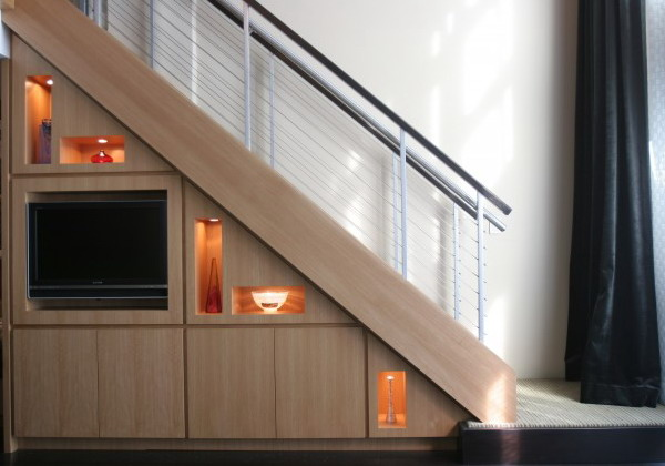 built in niches, drawers and a TV right in the staircase will save you a lot of space and will look very neat and chic