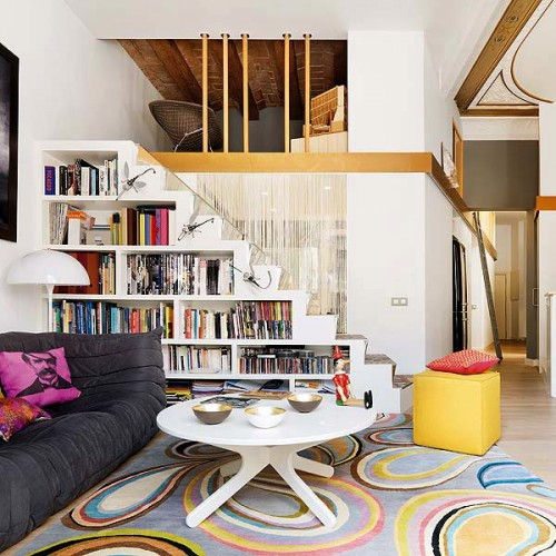 a staircase with an integrated bookcase will save much floor space in the room itself, it's a smart idea