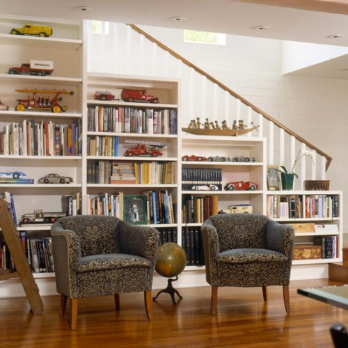 a staircase with whole bookcases under it - place a couple of chairs and you'll get a ready reading space
