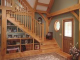 a wooden staircase with open built-in shelves and built-in lights for saving space and for a cool look