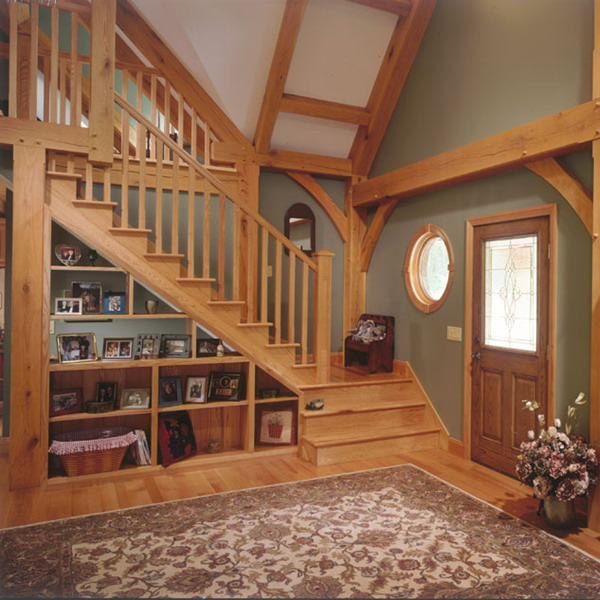 a wooden staircase with open built in shelves and built in lights for saving space and for a cool look