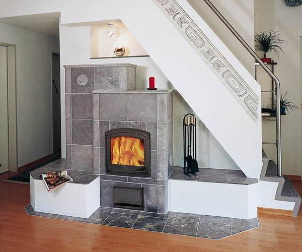place a fireplace or a hearth under the staircase saving much space and getting a very cozy feature for the space