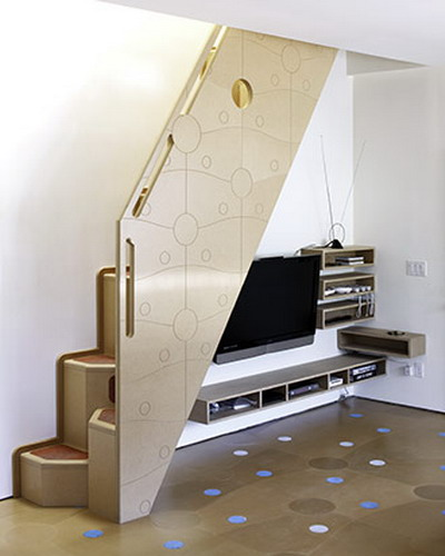 a TV and mini wall-mounted shelves under the stairs is a cool way to save some space and is great for small rooms