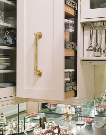 Pull out cabinets work well to store spices or grains