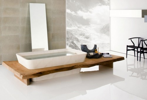 a minimalist bathroom with Japanese aesthetics, a wooden bench, a large mirror next to the tub and a statement artwork