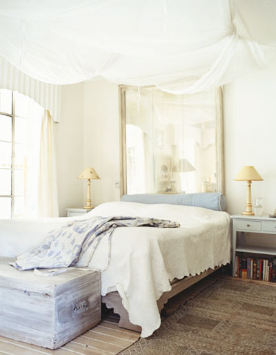 Big shabby chic mirror that acts as bed's headboard