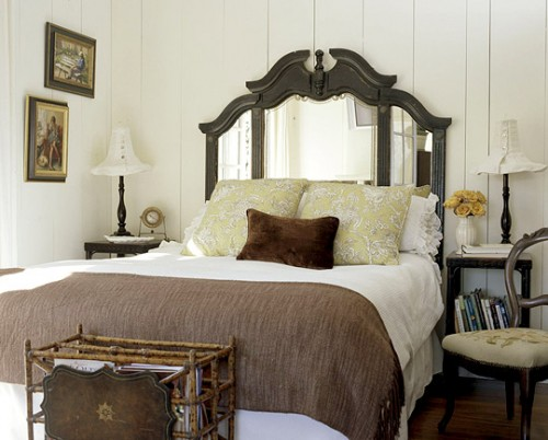 Traditional mirror as a bed's headboard