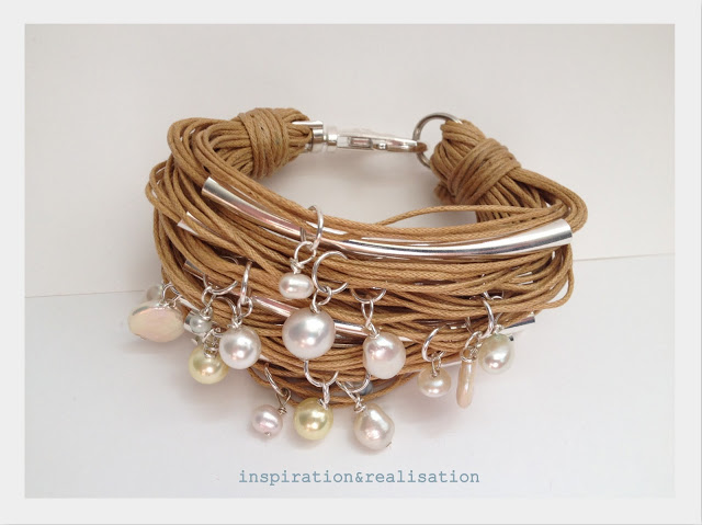 cord, tubes and pearl bracelet