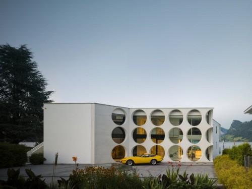 Lakeside Villa With Perforated Concrete Facade