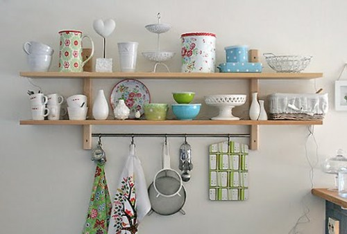 You can attach a rail with hooks to any open shelving solution