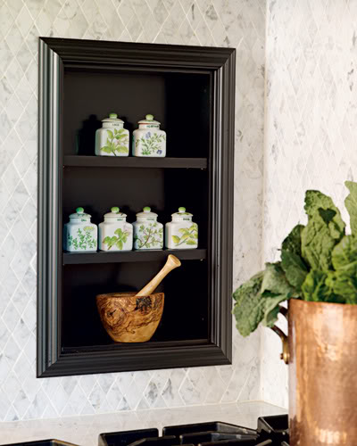 Open shelves in a niche is a perfect spice storage solution