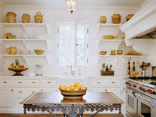 Using open shelves instead of large cabinets is a much more minimalist storage solution