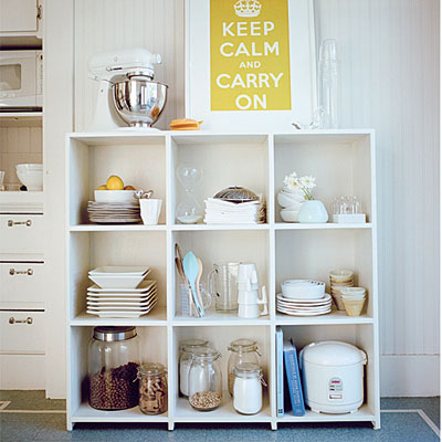Kitchen shelves could not only be hanged on a wall but also be a part of other storage solution