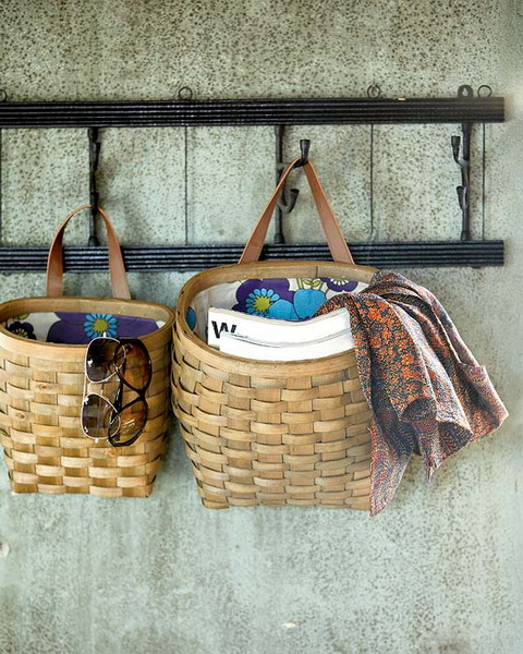 an entryway ladder and baskets hanging on it compose a cool storage unit for any space