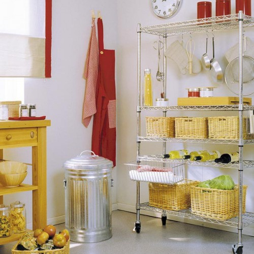 an open metal storage unit with some wicker cubbies for storign various stuff you may need