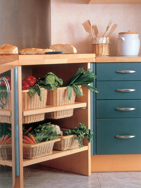 an open kitchen island with wicker cubbies and wicker drawers inside the island that offer storage space for vegetables and fruits