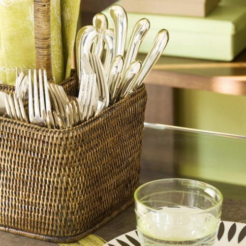 a rattan cubby as a cutlery holder is a cool rustic touch to any kitchen or dining space