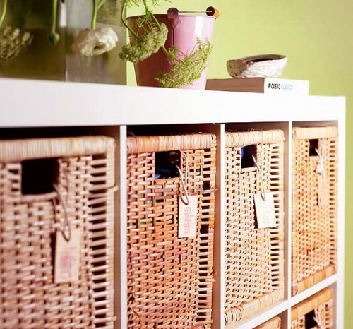 an open storage unit with wicker cubbies that make the storage closed, add a rustic feel and make it storage more comfortable