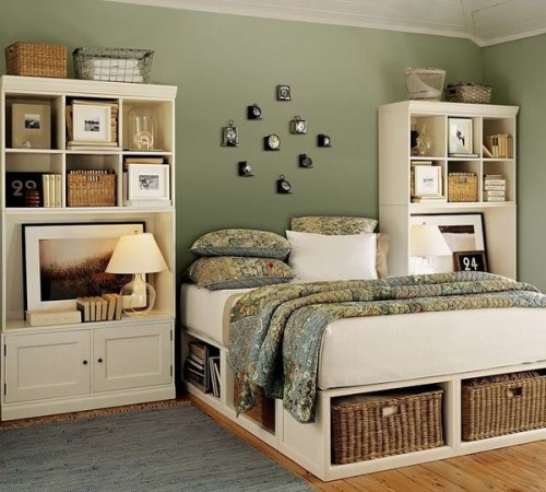 a bed with storage units - open ones for books and wicker cubbies for various stuff here and there