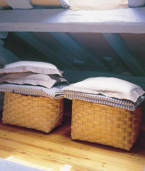 baskets with bedding and pillows can be used in your bedroom for storage